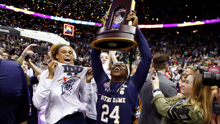 COLUMBUS, OH - APRIL 01:  Arike Ogunbowale #24 of the Notre Dame Fighting Irish hoists the NCAA championship trophy after scoring the game winning basket to defeat the Mississippi State Lady Bulldogs in the championship game of the 2018 NCAA Women's Final Four at Nationwide Arena on April 1, 2018 in Columbus, Ohio. The Notre Dame Fighting Irish defeated the Mississippi State Lady Bulldogs 61-58.  (Photo by Andy Lyons/Getty Images)
