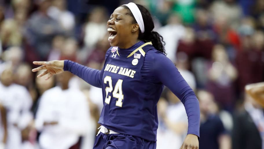 COLUMBUS, OH - APRIL 01:  Arike Ogunbowale #24 of the Notre Dame Fighting Irish celebrates after scoring the game winning basket with 0.1 seconds remaining in the fourth quarter to defeat the Mississippi State Lady Bulldogs in the championship game of the 2018 NCAA Women's Final Four at Nationwide Arena on April 1, 2018 in Columbus, Ohio. The Notre Dame Fighting Irish defeated the Mississippi State Lady Bulldogs 61-58.  (Photo by Andy Lyons/Getty Images)