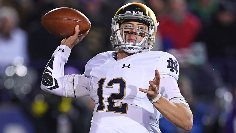 EVANSTON, IL - NOVEMBER 03:  Ian Book #12 of the Notre Dame Fighting Irish drops back to pass during a game against the Northwestern Wildcats at Ryan Field on November 3, 2018 in Evanston, Illinois.  Notre Dame defeated Northwestern 31-21.  (Photo by Stacy Revere/Getty Images)