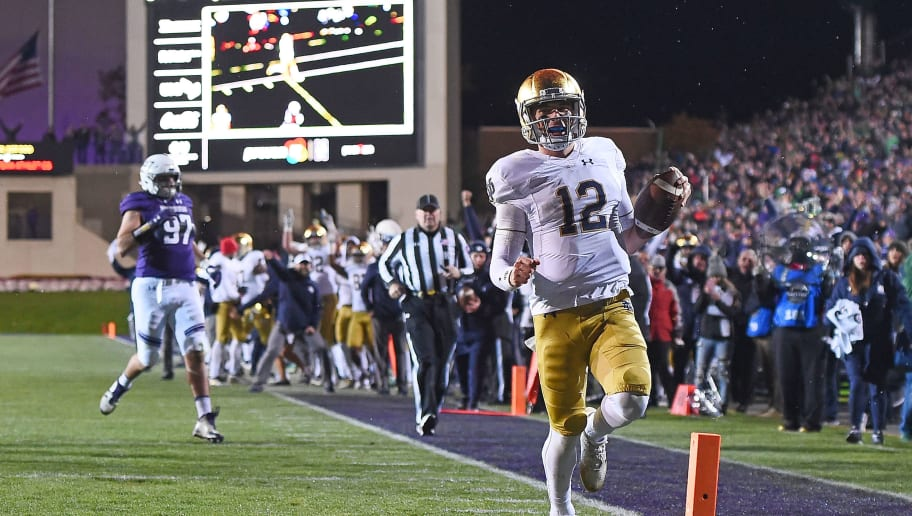 EVANSTON, IL - NOVEMBER 03:  Ian Book #12 of the Notre Dame Fighting Irish rushes for a touchdown during the second half of a game against the Northwestern Wildcats at Ryan Field on November 3, 2018 in Evanston, Illinois.  (Photo by Stacy Revere/Getty Images)