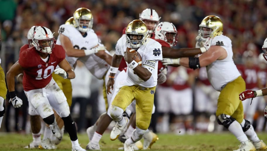 PALO ALTO, CA - NOVEMBER 25:  Brandon Wimbush #7 of the Notre Dame Fighting Irish scrambles with the ball against the Stanford Cardinal at Stanford Stadium on November 25, 2017 in Palo Alto, California.  (Photo by Ezra Shaw/Getty Images)