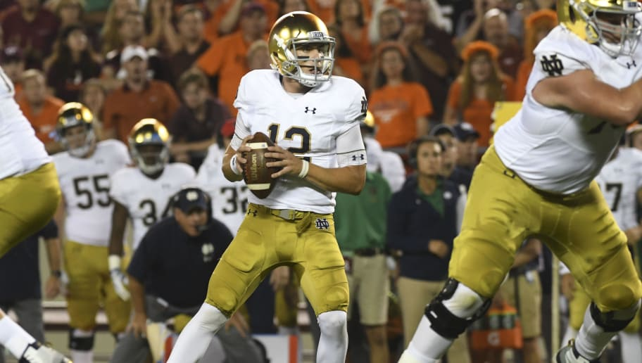 BLACKSBURG, VA - OCTOBER 6: Quarterback Ian Book #12 of the Notre Dame Fighting Irish looks to pass against the Virginia Tech Hokies in the first half at Lane Stadium on October 6, 2018 in Blacksburg, Virginia. (Photo by Michael Shroyer/Getty Images)
