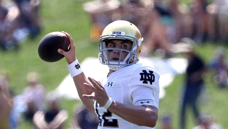 WINSTON SALEM, NC - SEPTEMBER 22:  Ian Book #12 of the Notre Dame Fighting Irish drops back to pass against the Wake Forest Demon Deacons during their game at BB&T Field on September 22, 2018 in Winston Salem, North Carolina.  (Photo by Streeter Lecka/Getty Images)