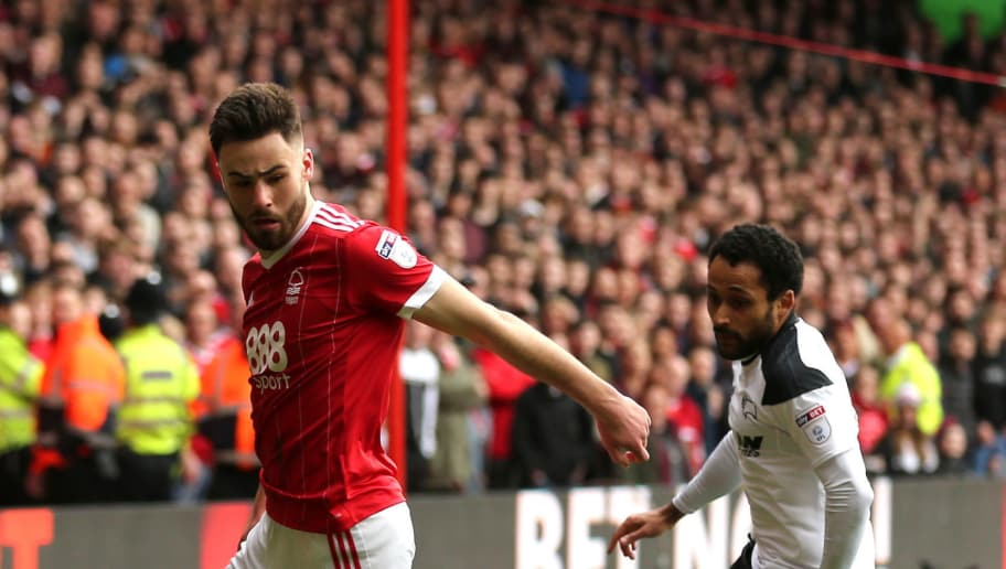 NOTTINGHAM, ENGLAND - MARCH 11: Ben Brereton of Nottingham Forest and Ikechi Anya of Derby County during the Sky Bet Championship match between Nottingham Forest and  Derby County at City Ground on March 11, 2018 in Nottingham, England. (Photo by James Williamson - AMA/Getty Images)
