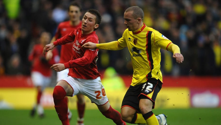 NOTTINGHAM, ENGLAND - FEBRUARY 05: Radoslaw Majewski of Nottingham Forest battles for the ball with Danny Drinkwater of Watford during the npower Championship match between Nottingham Forest and Watford at City Ground on February 5, 2011 in Nottingham, England.  (Photo by Laurence Griffiths/Getty Images)