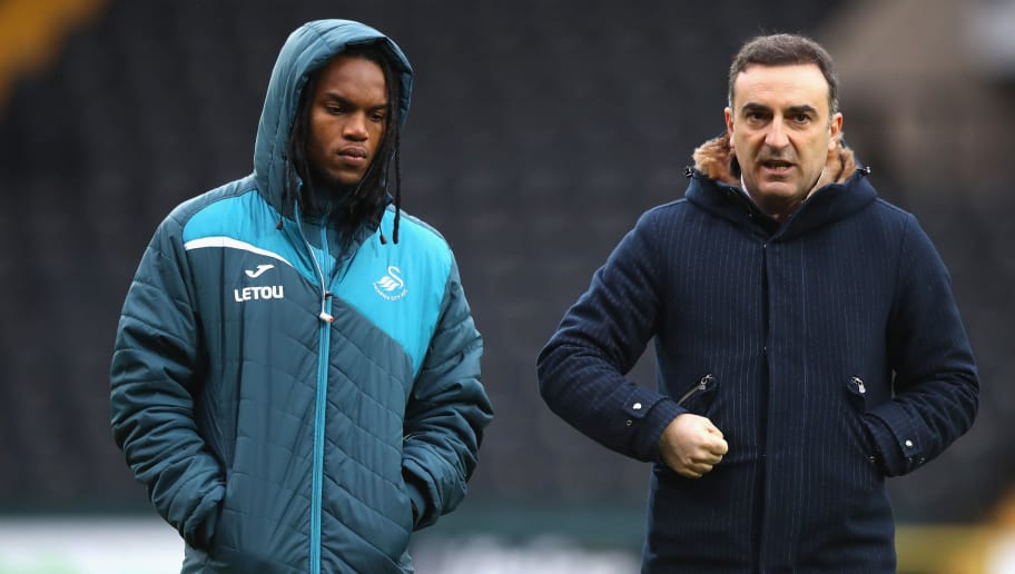 NOTTINGHAM, ENGLAND - JANUARY 27:  Carlos Carvalhal, Manager of Swansea City speaks with Renato Sanchez of Swansea City during The Emirates FA Cup Fourth Round match between Notts County and Swansea City at Meadow Lane on January 27, 2018 in Nottingham, England.  (Photo by Clive Mason/Getty Images)