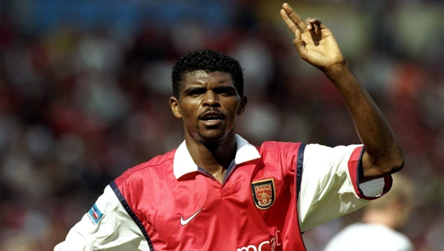 1 Aug 1999:  Nwankwo Kanu of Arsenal celebrates his goal during the FA Charity Shield match against Manchester United played at Wembley Stadium in London, England.  The match finished in a 2-1 victory to the Arsenal.   \ Mandatory Credit: Stu Forster /Allsport