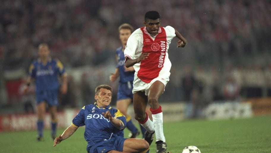 Nwankwo Kanu of Ajax is challenged by Dider Deschkrips of Juventus
