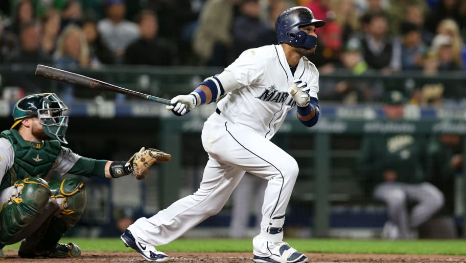 SEATTLE - SEPTEMBER 24:  Robinson Canó #22 of the Seattle Mariners bats during the game against the Oakland Athletics at Safeco Field on September 24, 2018 in Seattle, Washington.  The Athletics defeated the Mariners 7-3.  (Photo by Rob Leiter/MLB Photos via Getty Images)