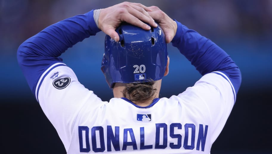 TORONTO, ON - MAY 17: Josh Donaldson #20 of the Toronto Blue Jays adjusts his helmet as he waits on first base during an injury delay in the third inning during MLB game action against the Oakland Athletics at Rogers Centre on May 17, 2018 in Toronto, Canada. (Photo by Tom Szczerbowski/Getty Images) *** Local Caption *** Josh Donaldson