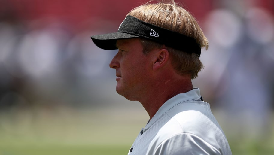 LOS ANGELES, CA - AUGUST 18:   Head coach Jon Gruden of the Oakland Raiders warms up with his team prior to the start of the game between the Los Angeles Rams and the Oakland Raiders at Los Angeles Memorial Coliseum on August 18, 2018 in Los Angeles, California. The Rams will come out winning at 19-15 (Photo by Joe Scarnici/Getty Images)