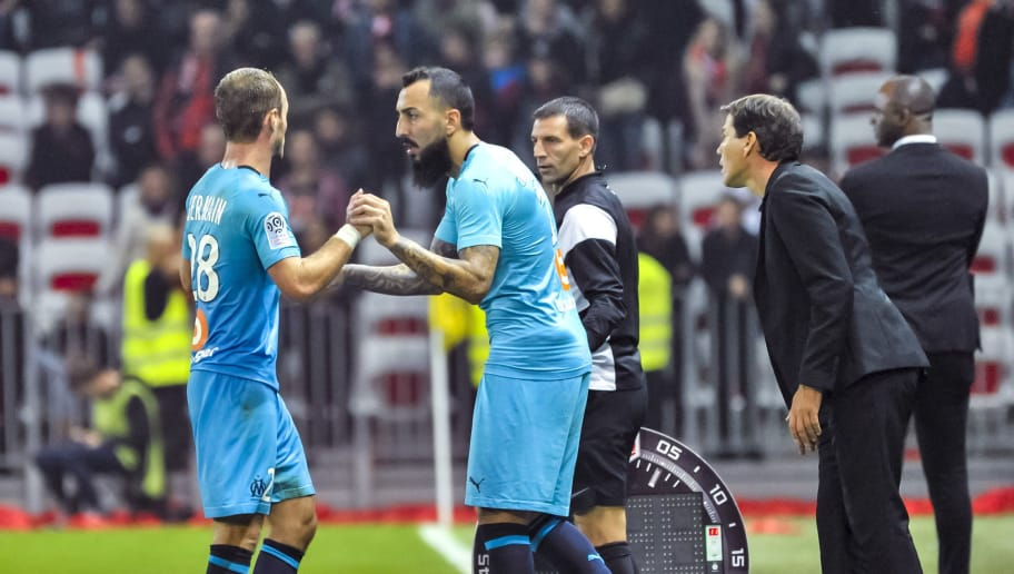 NICE, FRANCE - OCTOBER 21:  Valere Germain (L) of Olympique de Marseille reacts as he leaves the field and is replaced by teammate Konstantinos Mitroglou during the Ligue 1 match between OGC Nice and Olympique de Marseille at Allianz Riviera Stadium on October 21, 2018 in Nice, France.  (Photo by Olympique de Marseille/Getty Images)