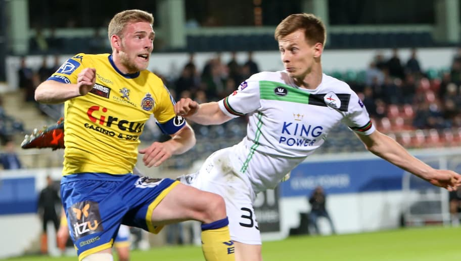 LEUVEN, BELGIUM - APRIL 28: Mathieu Maertens of OH Leuven in action with Laurent Jans of Waasland-Beveren during the Belgian First Divison A Europa League Playoffs tie between OH Leuven and Waasland-Beveren at Den Dreef Stadium on April 28th, 2018 in Leuven, Belgium. (Photo by Plumb Images/Getty Images)
