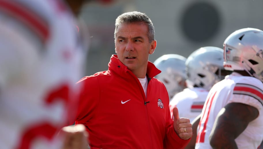 COLLEGE PARK, MD - NOVEMBER 17: Head coach Urban Meyer of the Ohio State Buckeyes runs on to the field with his team before playing against the Maryland Terrapins at Capital One Field on November 17, 2018 in College Park, Maryland. (Photo by Will Newton/Getty Images)