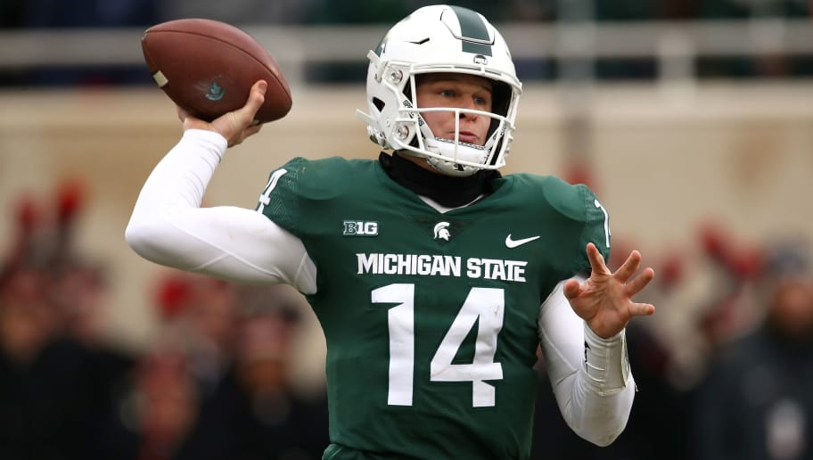 EAST LANSING, MI - NOVEMBER 10: Brian Lewerke #14 of the Michigan State Spartans throws a first half pass while playing the Ohio State Buckeyes at Spartan Stadium on November 10, 2018 in East Lansing, Michigan. (Photo by Gregory Shamus/Getty Images)