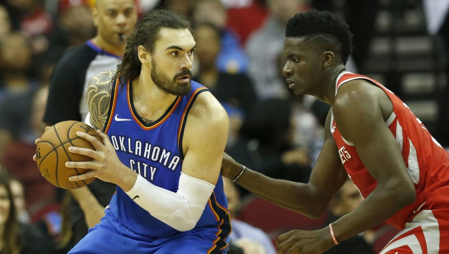 HOUSTON, TX - APRIL 07:  Clint Capela #15 of the Houston Rockets defends Steven Adams #12 of the Oklahoma City Thunder in the first half at Toyota Center on April 7, 2018 in Houston, Texas.  NOTE TO USER: User expressly acknowledges and agrees that, by downloading and or using this Photograph, user is consenting to the terms and conditions of the Getty Images License Agreement.  (Photo by Tim Warner/Getty Images)