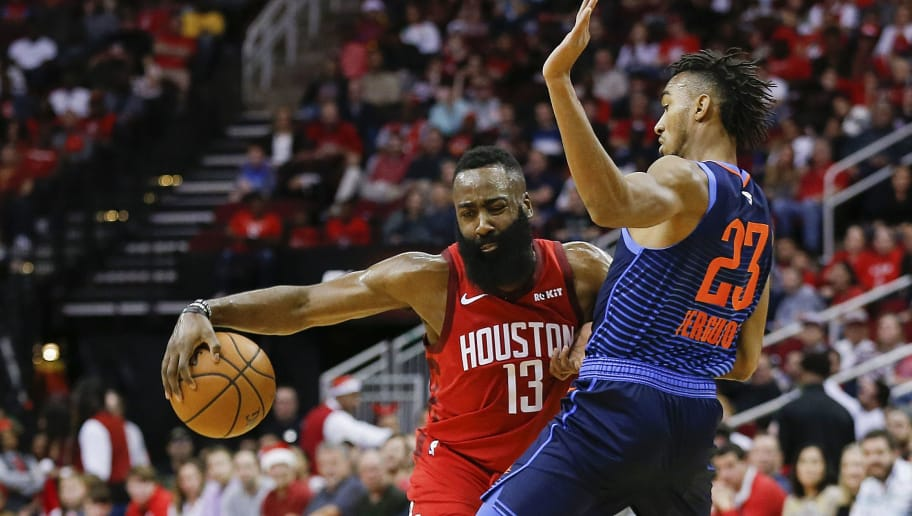 HOUSTON, TEXAS - DECEMBER 25: James Harden #13 of the Houston Rockets drives  around Terrance Ferguson #23 of the Oklahoma City Thunder during the first quarter at Toyota Center on December 25, 2018 in Houston, Texas. NOTE TO USER: User expressly acknowledges and agrees that, by downloading and or using this photograph, User is consenting to the terms and conditions of the Getty Images License Agreement. (Photo by Bob Levey/Getty Images)