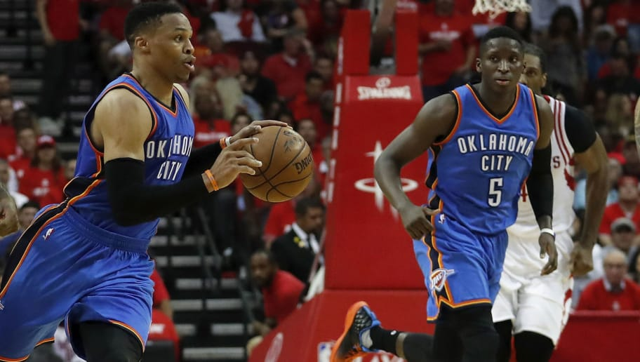 HOUSTON, TX - APRIL 19:  Russell Westbrook #0 of the Oklahoma City Thunder brings the ball down the courth on a fast break defended by Lou Williams #12 of the Houston Rockets in the second half of Game Two of the Western Conference quarterfinals game during the 2017 NBA Playoffs at Toyota Center on April 19, 2017 in Houston, Texas. NOTE TO USER: User expressly acknowledges and agrees that, by downloading and or using this photograph, User is consenting to the terms and conditions of the Getty Images License Agreement.  (Photo by Tim Warner/Getty Images)