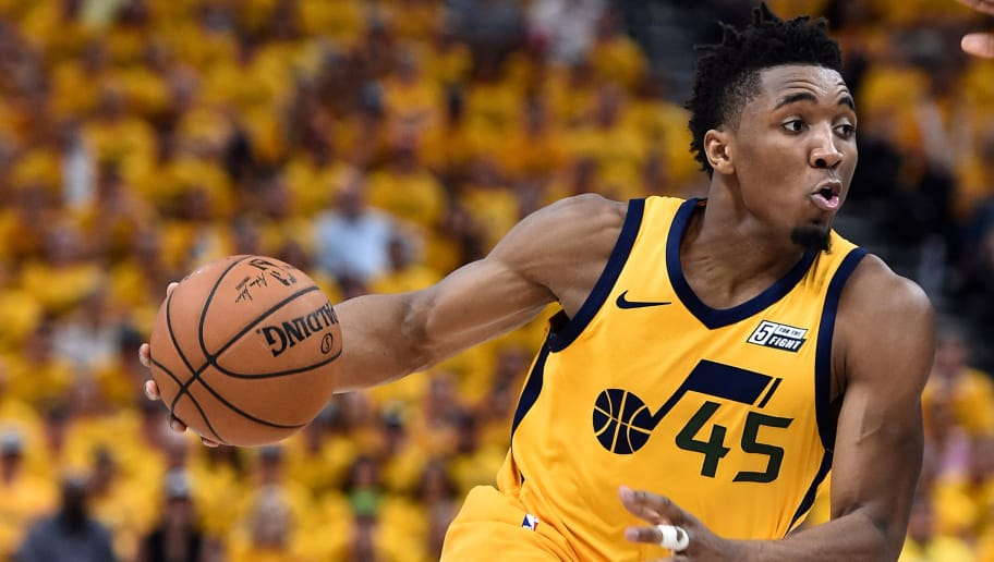 SALT LAKE CITY, UT - APRIL 27: Donovan Mitchell #45 of the Utah Jazz drives with the ball during Game Six of Round One of the 2018 NBA Playoffs against the Oklahoma City Thunder at Vivint Smart Home Arena on April 27, 2018 in Salt Lake City, Utah.  NOTE TO USER: User expressly acknowledges and agrees that, by downloading and or using this photograph, User is consenting to the terms and conditions of the Getty Images License Agreement. (Photo by Gene Sweeney Jr./Getty Images)