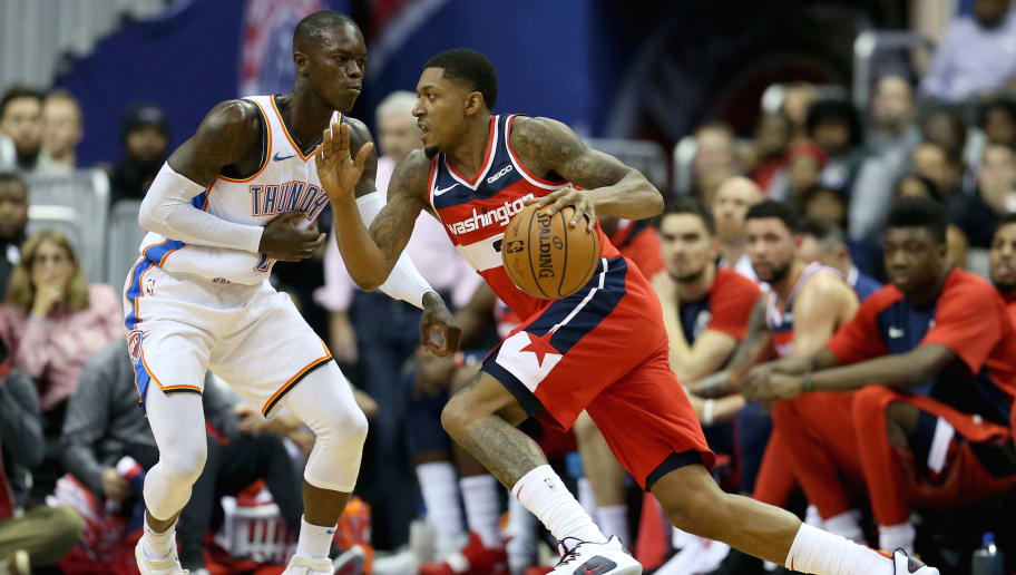 WASHINGTON, DC - NOVEMBER 02: Bradley Beal #3 of the Washington Wizards dribbles past Dennis Schroder #17 of the Oklahoma City Thunder during the first half at Capital One Arena on November 2, 2018 in Washington, DC. NOTE TO USER: User expressly acknowledges and agrees that, by downloading and or using this photograph, User is consenting to the terms and conditions of the Getty Images License Agreement. (Photo by Will Newton/Getty Images)