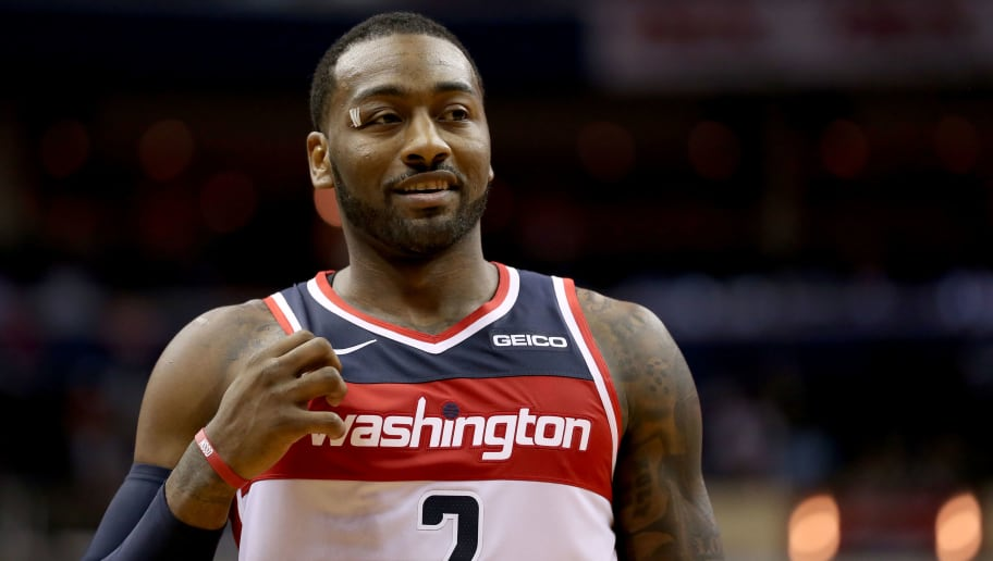 WASHINGTON, DC - NOVEMBER 02: John Wall #2 of the Washington Wizards looks on during the first half against the Oklahoma City Thunder at Capital One Arena on November 2, 2018 in Washington, DC. NOTE TO USER: User expressly acknowledges and agrees that, by downloading and or using this photograph, User is consenting to the terms and conditions of the Getty Images License Agreement. (Photo by Will Newton/Getty Images)