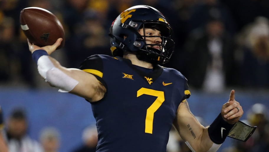MORGANTOWN, WV - NOVEMBER 23:  Will Grier #7 of the West Virginia Mountaineers in action against the Oklahoma Soonersrs on November 23, 2018 at Mountaineer Field in Morgantown, West Virginia.  (Photo by Justin K. Aller/Getty Images)