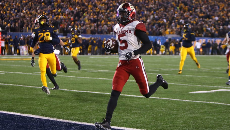 MORGANTOWN, WV - NOVEMBER 23:  Marquise Brown #5 of the Oklahoma Sooners catches and runs for a 45 yard touchdown against the West Virginia Mountaineers on November 23, 2018 at Mountaineer Field in Morgantown, West Virginia.  (Photo by Justin K. Aller/Getty Images)