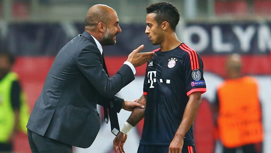 PIRAEUS, GREECE - SEPTEMBER 16:  Head coach Pep Guardiola of Muenchen talks to Thiago Alcantara during the UEFA Champions League Group F match between Olympiacos FC and FC Bayern Muenchen at Karaiskakis Stadium on September 16, 2015 in Piraeus, Greece.  (Photo by Alex Grimm/Bongarts/Getty Images)