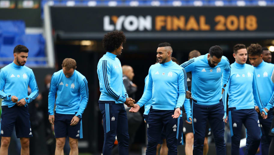LYON, FRANCE - MAY 15:  Luiz Gustavo of Marseille talks to Dimitri Payet of Marseille during an Olympique de Marseille training session ahead of the the UEFA Europa League Final against Club Atletico de Madrid at Stade de Lyon on May 15, 2018 in Lyon, France.  (Photo by Michael Steele/Getty Images)