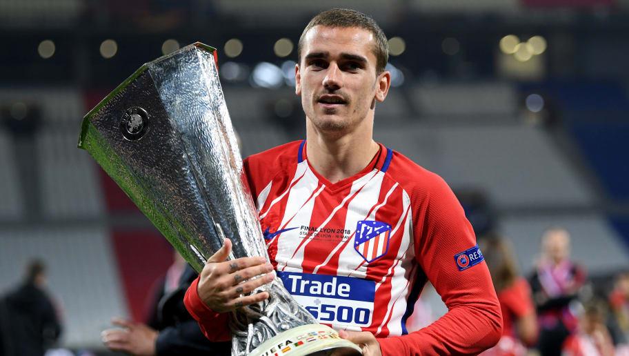 LYON, FRANCE - MAY 16:  Antoine Griezmann of Atletico Madrid celebrates with the trophy following the UEFA Europa League Final between Olympique de Marseille and Club Atletico de Madrid at Stade de Lyon on May 16, 2018 in Lyon, France.  (Photo by Matthias Hangst/Getty Images)