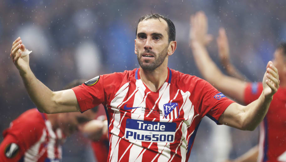 LYON, FRANCE - MAY 16: Diego Godin of Athletico Madrid celebrates after Antoine Griezmann of Athletico Madrid scores his second goal during the UEFA Europa League Final between Olympique de Marseille and Club Atletico de Madrid at Stade de Lyon on May 16, 2018 in Lyon, France. (Photo by Ian MacNicol/Getty Images)
