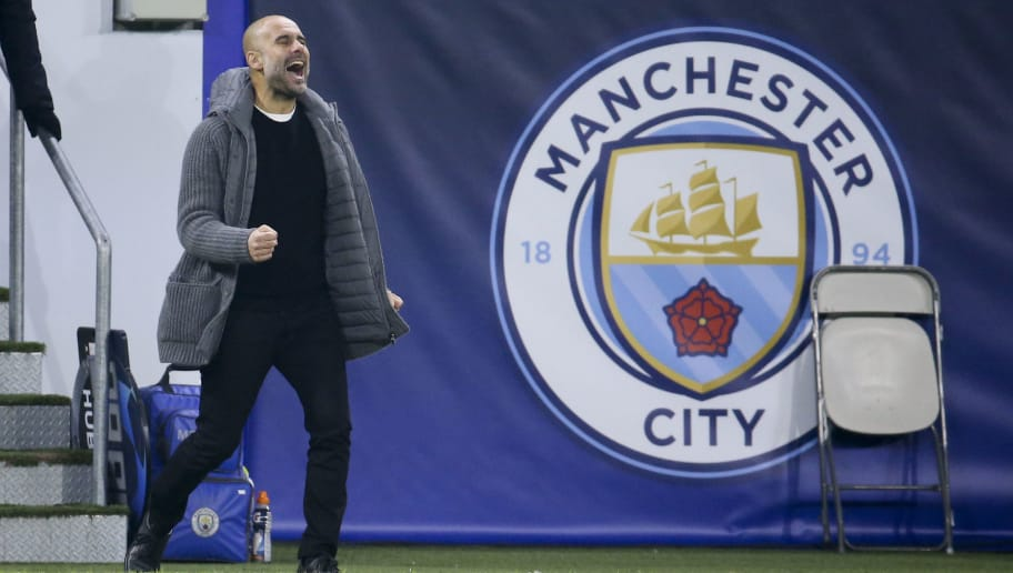 LYON, FRANCE - NOVEMBER 27: Coach of Manchester City Pep Guardiola celebrates the second and tying goal at 2-2 of Man City during the UEFA Champions League match between Olympique Lyonnais (OL) and Manchester City at Groupama Stadium on November 27, 2018 in Lyon, France. (Photo by Jean Catuffe/Getty Images)