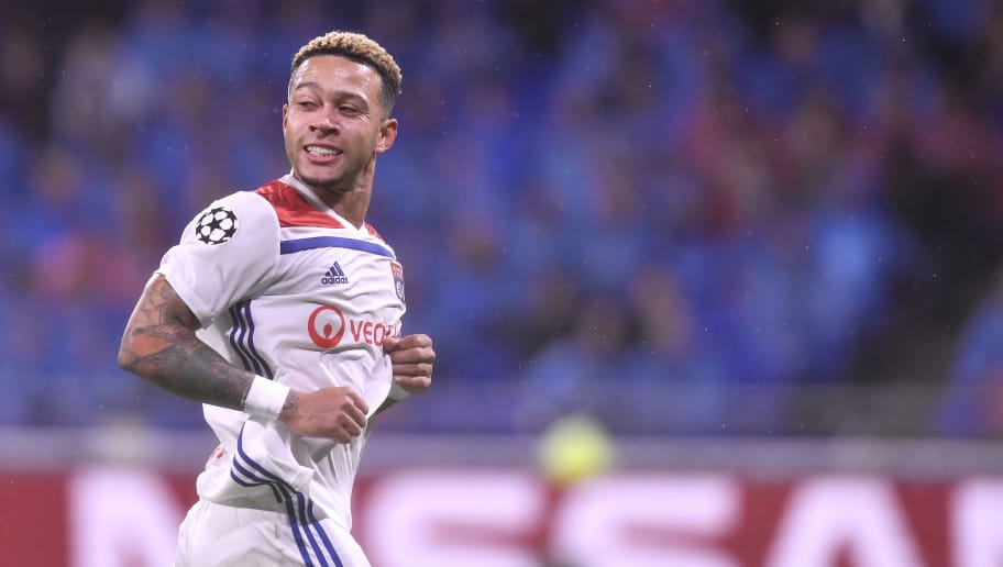 LYON, FRANCE - NOVEMBER 07:  Memphis Depay of Olympique Lyonnais reacts during the Group F match of the UEFA Champions League between Olympique Lyonnais and TSG 1899 Hoffenheim at Groupama Stadium on November 7, 2018 in Lyon, France.  (Photo by Aurelien Meunier/Getty Images)