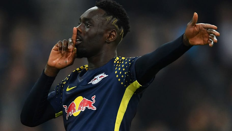 MARSEILLE, FRANCE - APRIL 12:  Jean-Kevin Augustin of RB Leipzig celebrates his team's goal during the UEFA Europa League quarter final leg two match between Olympique Marseille and RB Leipzig at Stade Velodrome on April 12, 2018 in Marseille, France.  (Photo by Valerio Pennicino/Bongarts/Getty Images)