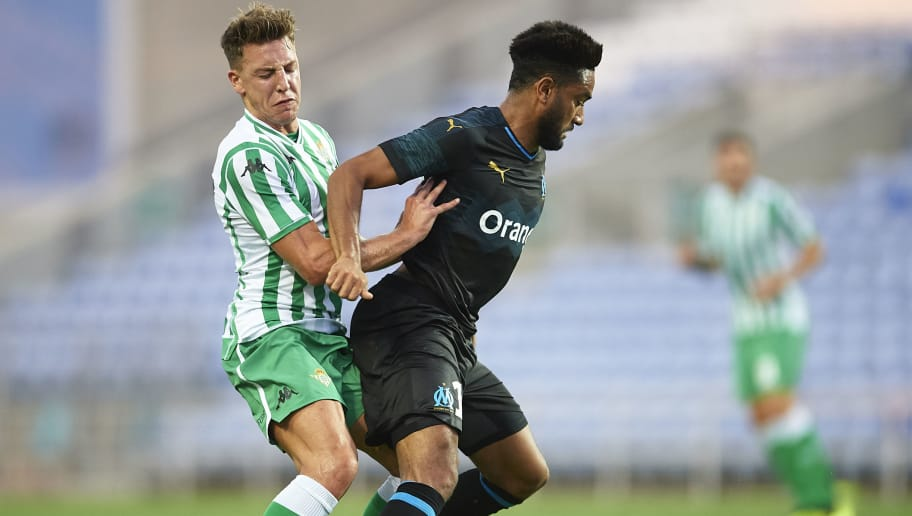 FARO, PORTUGAL - JULY 25:  Jordan Amavi of Olympique Marseille (R) being followed by Francisco Javier Guerrero 'Francis' of Real Betis Balompie (L) during the pre-season friendly match between Olympique Marseille and Real Betis at Estadio Algarve on July 25, 2018 in Faro, Portugal.  (Photo by Aitor Alcalde Colomer/Getty Images)