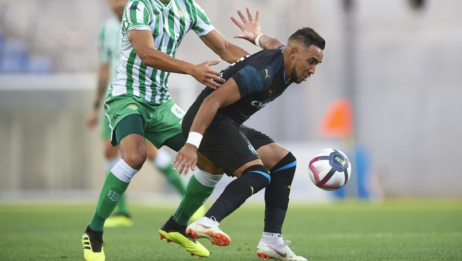 FARO, PORTUGAL - JULY 25:  Dimitri Payet of Olympique Marseille (R) being followed by Aissa Mandi of Real Betis Balompie (L) during the pre-season friendly match between Olympique Marseille and Real Betis at Estadio Algarve on July 25, 2018 in Faro, Portugal.  (Photo by Aitor Alcalde Colomer/Getty Images)