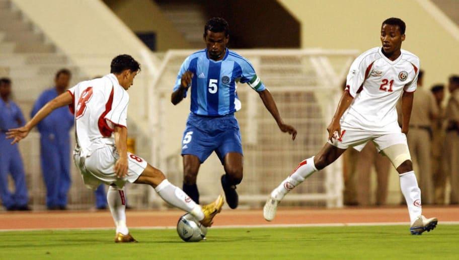 Omani player Badar al-Maimani (L) and Ah