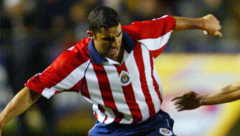 Omar Briseno of Tigres (L) and Salvador