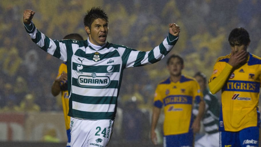 Oribe Peralta (L) of Santos celebrates his goal against Tigres, during their Mexican Apertura 2011 tournament football final, in Monterrey, Nuevo Leon State, Mexico, on December 11, 2011. AFP PHOTO/Alfredo Estrella (Photo credit should read ALFREDO ESTRELLA/AFP/Getty Images)
