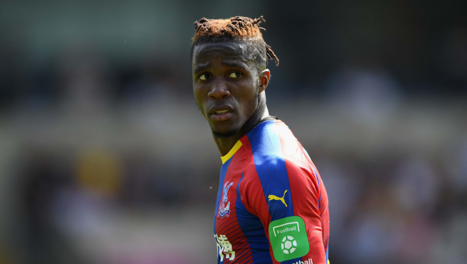 OXFORD, ENGLAND - JULY 21:  Crystal Palace striker Wilfried Zaha in action during a Pre-Season Friendly match between Oxford United and Crystal Palce at Kassam Stadium on July 21, 2018 in Oxford, England.  (Photo by Stu Forster/Getty Images)