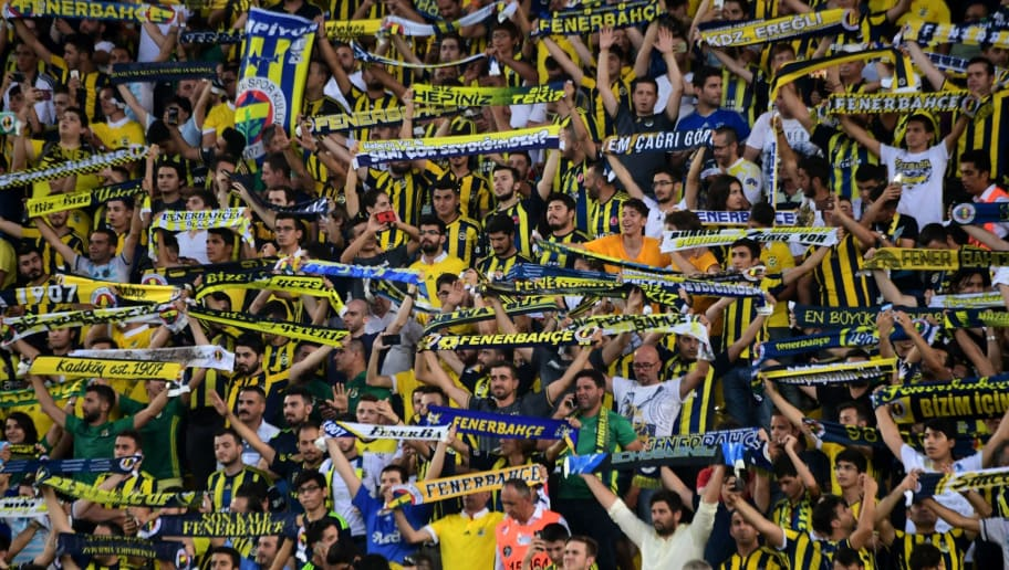Fenerbahce's cheer for their team during the UEFA Europa League third qualifying round second match between Fenerbahce and Sturm Graz at Fenerbahce's Ulker Stadium in Istanbul on August 3, 2017. / AFP PHOTO / OZAN KOSE        (Photo credit should read OZAN KOSE/AFP/Getty Images)