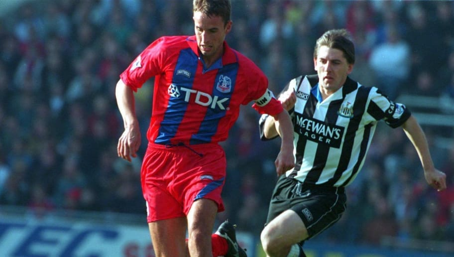 15 OCT 1994:  GARETH SOUTHGATE OF CRYSTAL PALACE IS PURSUED BY PETER BEARDSLEY OF NEWCASTLE UNITED DURING THE PREMIERSHIP GAME AT SELHURST PARK.  CREDIT: CLIVE MASON/ALLSPORT Mandatory Credit: Clive Mason/ALLSPORT