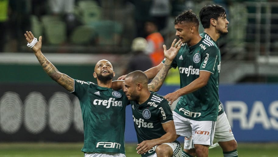 SAO PAULO, BRAZIL - NOVEMBER 14: Felipe Melo (L) of Palmeiras celebrates with teammates after scoring the third goal of his team during a match between Palmeiras and Fluminense for the Brasileirao Series A 2018 at Allianz Parque on November 14, 2018 in Sao Paulo, Brazil. (Photo by Miguel Schincariol/Getty Images) (Photo by Miguel Schincariol/Getty Images)