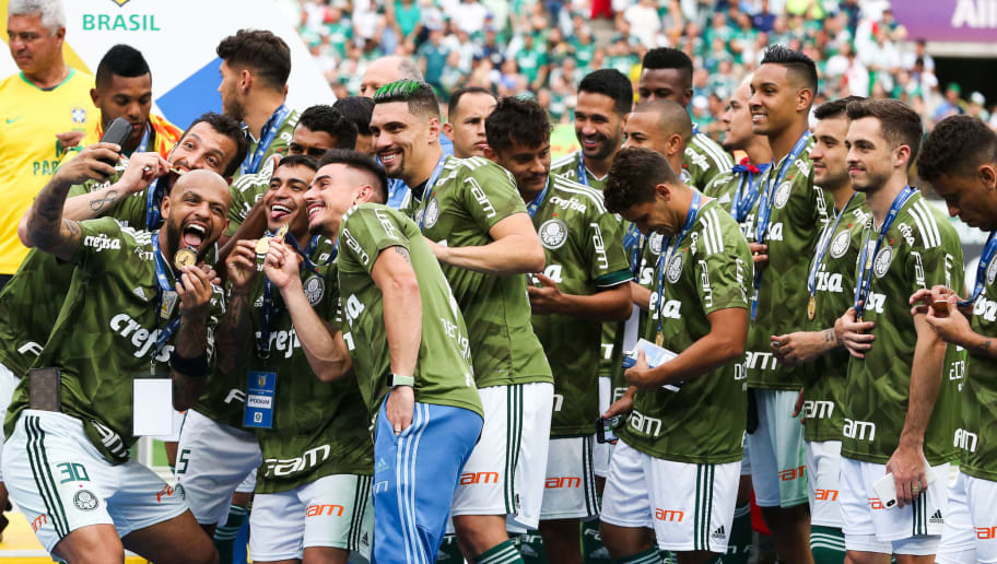 SAO PAULO, BRAZIL - DECEMBER 02: Players of Palmeiras celebrate after winning the Brasileirao 2018 after the match against Vitora at Allianz Parque Stadium on December 02, 2018 in Sao Paulo, Brazil. (Photo by Alexandre Schneider/Getty Images)