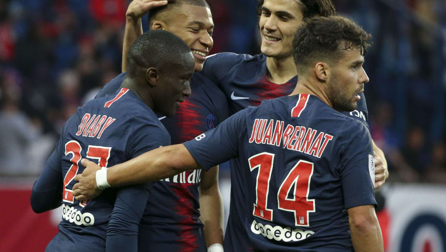 PARIS, FRANCE - OCTOBER 20: Kylian Mbappe of PSG celebrates his goal with Moussa Diaby, Edinson Cavani, Juan Bernat during the french Ligue 1 match between Paris Saint-Germain (PSG) and Amiens SC at Parc des Princes stadium on October 20, 2018 in Paris, France. (Photo by Jean Catuffe/Getty Images)