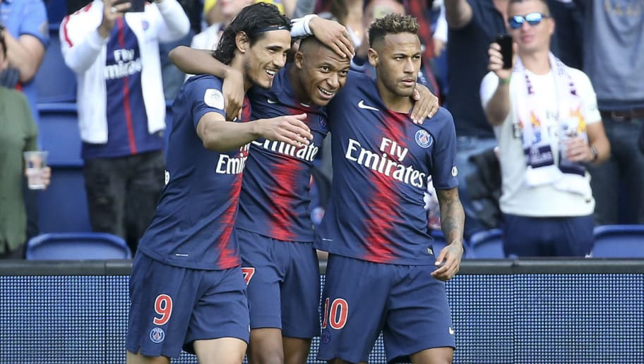 PARIS, FRANCE - AUGUST 25: Kylian Mbappe of PSG celebrates his goal between Edinson Cavani and Neymar Jr during the french Ligue 1 match between Paris Saint-Germain and SCO Angers at Parc des Princes stadium on August 25, 2018 in Paris, France. (Photo by Jean Catuffe/Getty Images)