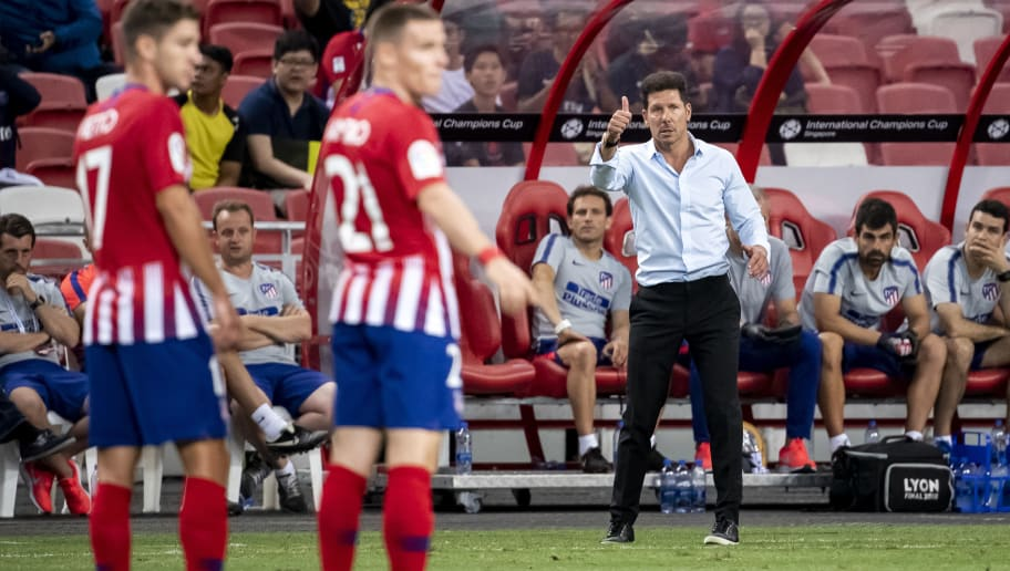 SINGAPORE - JULY 30: Diego Simeone, Manager of Paris Saint Germain gives instructions to his players during the International Champions Cup 2018 match between Paris Saint Germain and Club Atletico de Madrid at the National Stadium on July 30, 2018 in Singapore. (Photo by PictoBank/Getty Images)