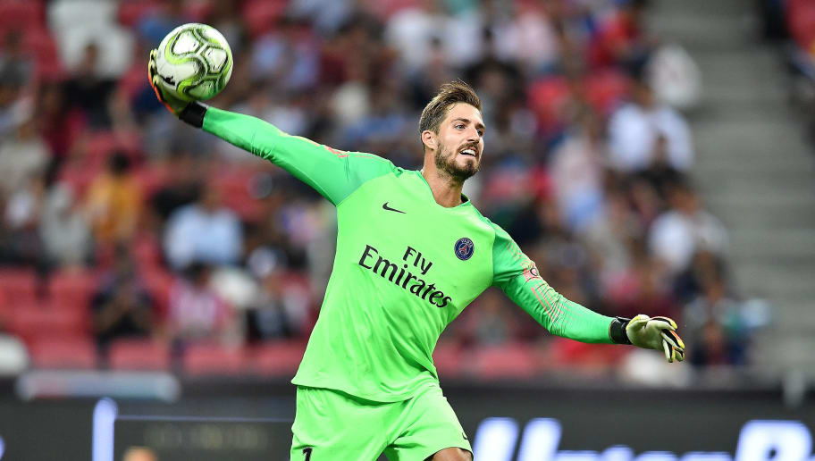 SINGAPORE - JULY 30: Kevin Trapp #1 of Paris Saint Germain throws the ball during the International Champions Cup match between Paris Saint Germain and Clu b de Atletico Madrid at the National Stadium on July 30, 2018 in Singapore.  (Photo by Thananuwat Srirasant/Getty Images for ICC)