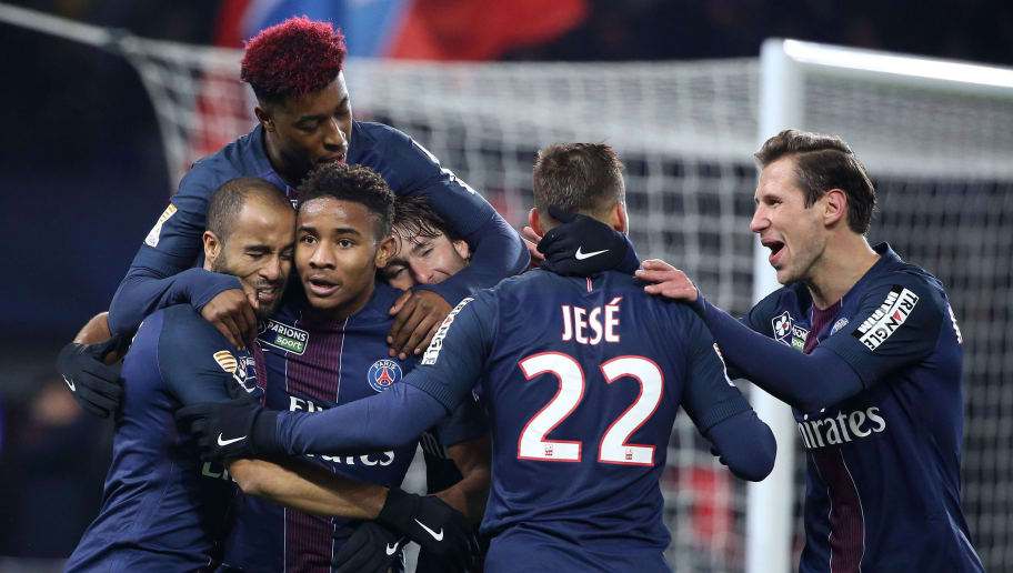PARIS, FRANCE - DECEMBER 14: Lucas Moura of PSG celebrates his goal with Christopher Nkunku, Maxwell Scherrer, Jese Rodriguez, Grzegorz Krychowiak, Presnel Kimpembe (top) during the French League Cup (Coupe de la Ligue) match between Paris Saint-Germain (PSG) and Lille OSC at Parc des Princes stadium on December 14, 2016 in Paris, France. (Photo by Jean Catuffe/Getty Images,)