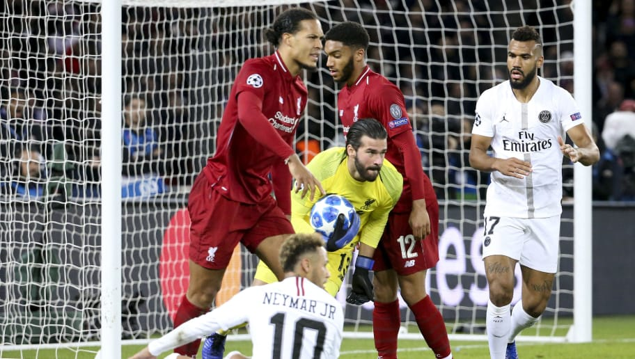 PARIS, FRANCE - NOVEMBER 28: Goalkeeper of Liverpool Alisson Becker between Virgil Van Dijk, Joe Gomez of Liverpool, Neymar Jr, Eric Maxim Choupo-Moting of PSG during the UEFA Champions League Group C match between Paris Saint-Germain (PSG) and Liverpool FC at Parc des Princes stadium on November 28, 2018 in Paris, France. (Photo by Jean Catuffe/Getty Images)